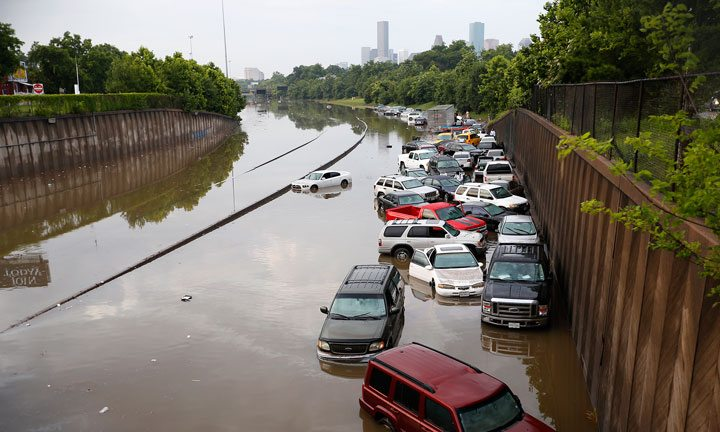 Motorists are stranded along Interstate 45 along North Main in Houston, Texas, after storms flooded the area on Tuesday.   Cody Duty/Houston Chronicle via AP