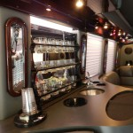 AES Limousine Service's newest addition to the fleet is a limousine coach with a bar full of glasses, two televisions and shifting ambient lighting.   Courtesy photo