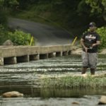 Barry Robinson, of Front Royal,  fishes in the Shenandoah River at Morgan's Ford in Warren County on a recent hot afternoon.  Today's high will be near 82.  The forecast calls for scattered showers this afternoon and then showers and thunderstorms likely after 4 p.m.  Rich Cooley/Daily