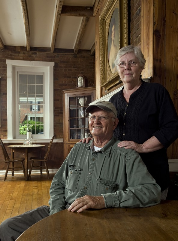 George and Becky Reeves relax inside a dining room at the Wayside Inn in Middletown on Thursday. The couple purchased the inn in October 2013 and have listed the property for sale. Rich Cooley/Daily