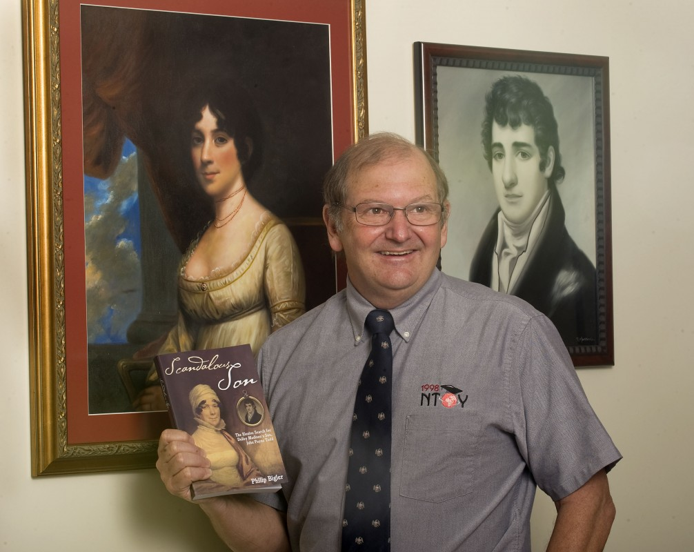 Philip Bigler,  a retired James Madison University professor and the 1998 National Teacher of the Year, stands beside portraits of Dolley Madison and her son, John Payne Todd, in the basement of his home in Quicksburg.  Bigler has written a book on Todd.  Rich Cooley/Daily