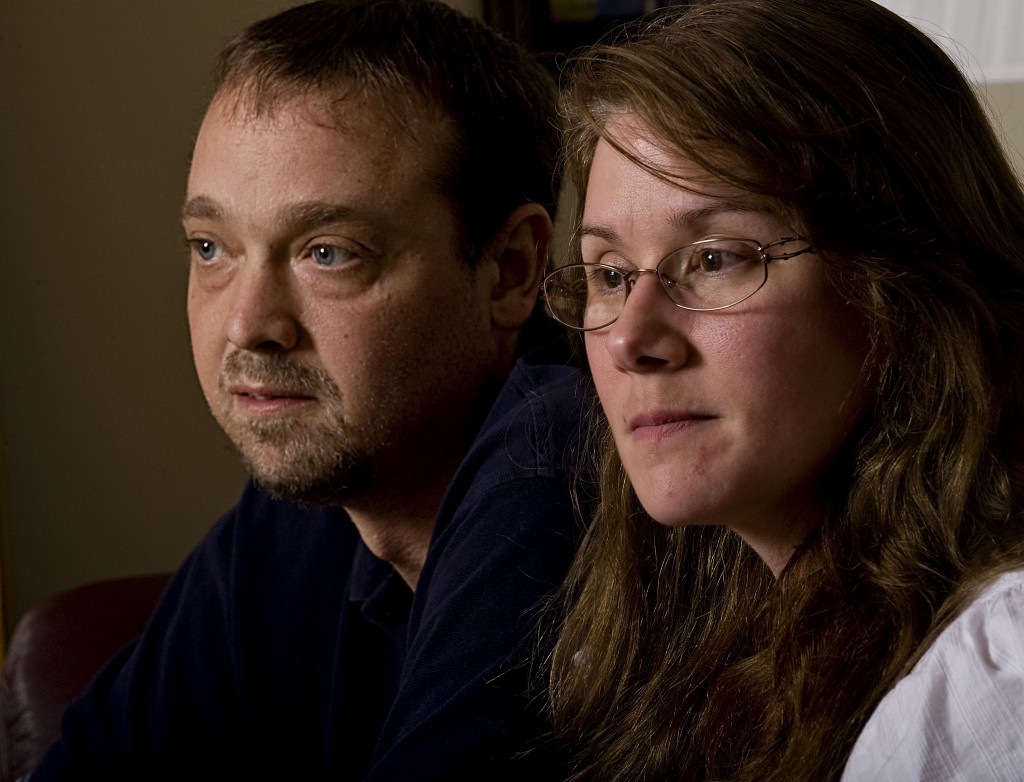 Paul Smoot, 36, of Strasburg, sits beside his wife Kutrina inside his mother's home n Stephens City recently. Paul Smoot was born with immune deficiency disorder and now needs a liver transplant from a live donor.  Rich Cooley/Daily