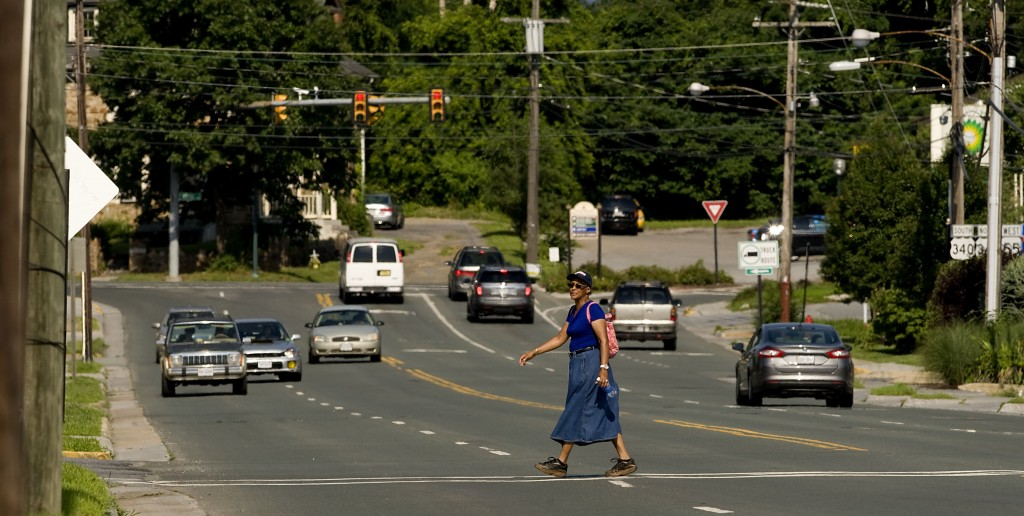 Artelia Butler crosses this section of South Street in Front Royal on her way home Tuesday. The town has embarked on a project to beautify South Street.   Rich Cooley/Daily