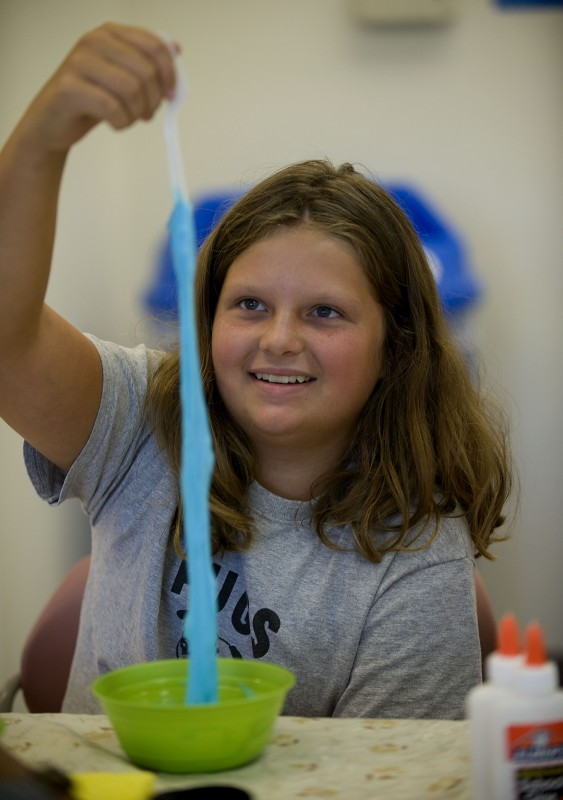 Lindsey Ridgy, 11, of Woodstock, holds up a strip of gloop she made during the Playing With Science workshop at the Shenandoah County Extension Service and offered by the 4-H club. Participants used everyday household items to create science projects. This one used glue, food coloring, borax, and water.  The Extension Office is offering other camps,  including Exploring the World of Insects, Basket Weaving, Cupcake Creations, and Woodworking Crafts. Students do not have to be current 4-H members to participate. Pre-registration is required by calling 459-6140. Rich Cooley/Daily