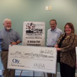 The Front Royal Independent Business Alliance donated $2,000 to the Warren County Summer Backpack Program from last month's Taste of the Town event held in downtown Front Royal. Shown left to right are Arline Link and George McIntyre of the alliance, Larry Elliot with C-CAP and the backpack program, Katrina Meade with City National Bank, and Craig Laird from the alliance. Courtesy photo