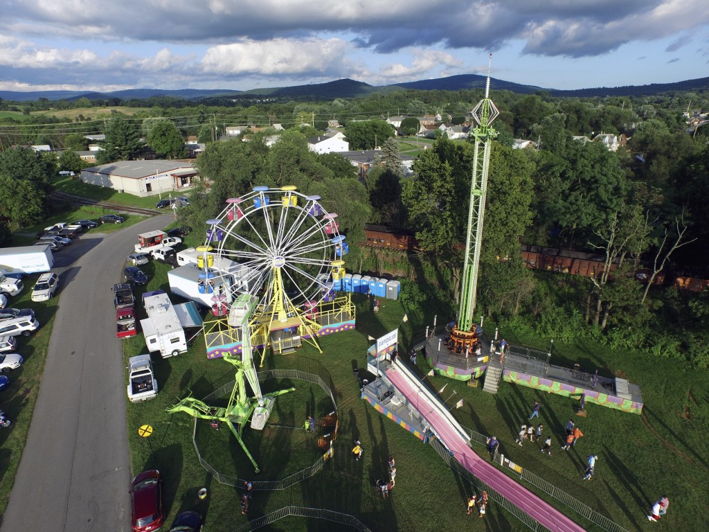 This drone's eye view of the Front Royal Fireman's Carnival this week was captured by Ryan Harold, 17, a rising senior at Warren County High School, as he flew a drone above this scene. The carnival, located  at the 8th Street carnival lot next to Bing Crosby Stadium,  continues from 3 to 11 p.m. through Saturday.  Attractions include nightly bingo games and 22 rides. Photo courtesy of Ryan Harold