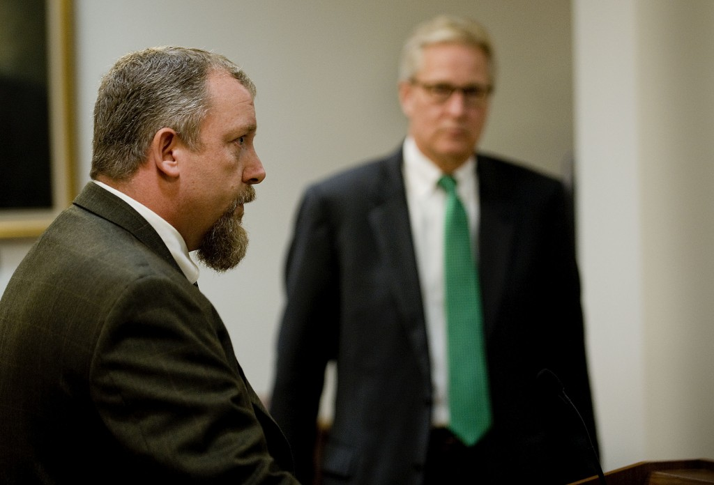 Bill Metcalf, Alcohol Tobacco Firearms  special agent, speaks during a news conference at U.S. District Court in Harrisonburg  while U.S. Attorney Donald Wolthuis looks on after the sentencing Thursday morning of Matthew Santiago of New York.  Rich Cooley/Daily