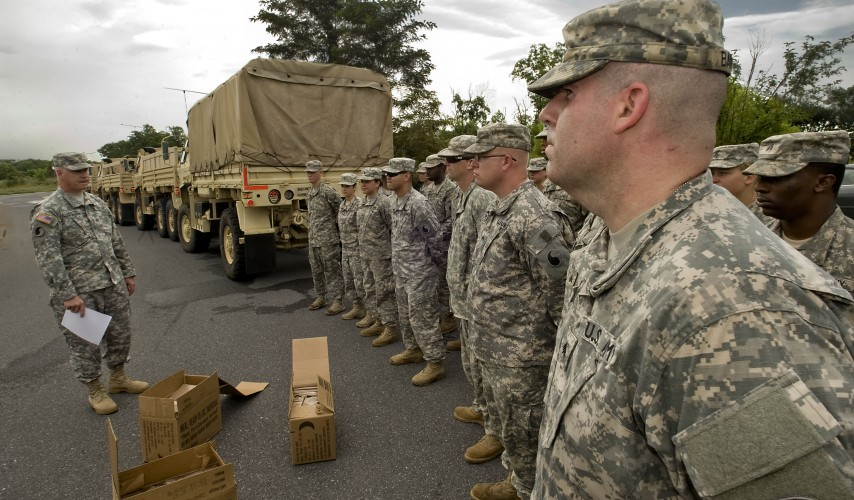 Michael Martin, 40, a computer detection systems specialist from Manassas, stands in formation with the Virginia National Guard's Winchester-based 3rd Battalion, 116th Infantry Regiment, 116th Infantry Brigade Combat Team, as they prepare to travel to Fort Pickett near Blackstone. The group has received a mobilization order to enter active federal service for duty in Southwest Asia. Rich Cooley/Daily