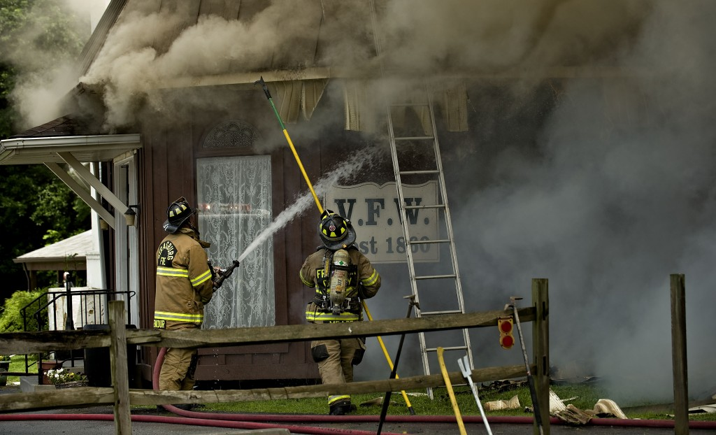 Firefighters battle the fire at the Front Royal VFW Post 1860 on July 11.  Rich Cooley/Daily file