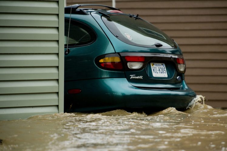 Water surrounds this car parked between Spring and South streets in Woodstock. Rich Cooley/Daily
