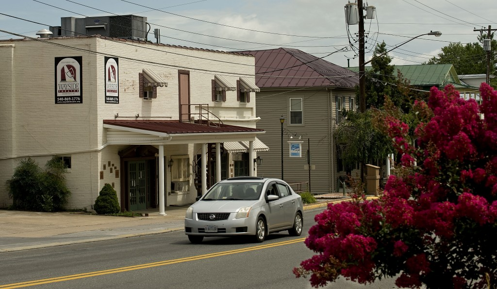 A car travels past the Wayside Theater in Middletown on Tuesday.  Rich Cooley/Daily