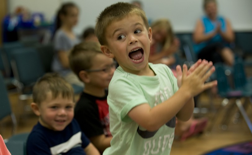 William Richards, 4, of Woodstock, reacts to The Loud Poetry Guy at the  Shenandoah County Library on Tuesday.    Rich Cooley/Daily