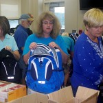 Rotary Club of Warren County members. from left, Dave Hardy, Carol Hardy, Rhonda North and Connemara Tolson fill backpacks with supplies for area students.  Courtesy Photo