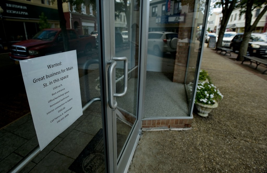 A sign shows retail space available for occupancy along Main Street in Front Royal.  Rich Cooley/Daily
