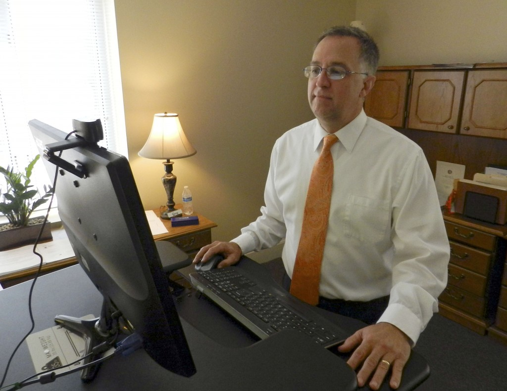 Warren County Superintendent of Schools L. Gregory Drescher stands at an adjustable keyboard in his office. Among his plans for the new school year is the hope of implementing a health and wellness initiative for students and staff.  Josette Keelor/Daily