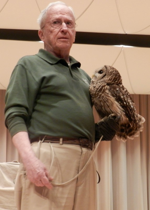 Kent Knowles, of the Raptor Conservancy of Virginia, holds a barred owl at Armstrong Hall at Shenandoah University in Winchester on July 23.  Kevin Green/Daily