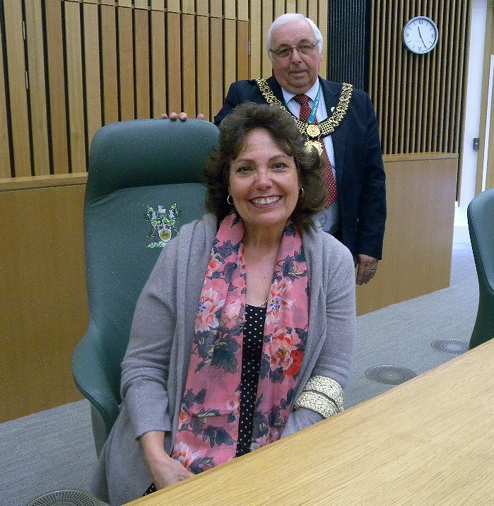 The Honorable Paul Pegg, the Lord mayor of Derby, England, right, allows Mary Powers, of Front Royal,  to sit in his chair in the city's council chamber. Courtesy photo