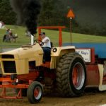 Travis Vizelbiss, of Clear Spring, Maryland, drives his Case tractor during the truck and tractor pull at Warren County Fairgrounds Monday night. Rich Cooley/Daily