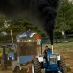 Marshall Beidel of Funettsburg, Pennsylvania, drives his tractor during the truck and tractor pull at Warren County Fairgrounds Monday night,  Rich Cooley/Daily
