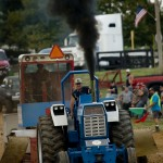 Donnie Gochenour of Luray competes with his Ford 9000 in the 11000 Hot Farm Tractors class during the tractor pull at Warren County Fairgrounds Monday night. Rich Cooley/Daily