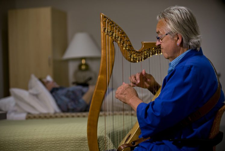 Allen Dec, a certified music practitioner, regularly plays his harp to patients as part of the Integrative Care Program at Winchester Medical Center. The program includes    complementary services to help patients ease stress while receiving treatment for       illnesses or other medical conditions.   Rich Cooley/Daily