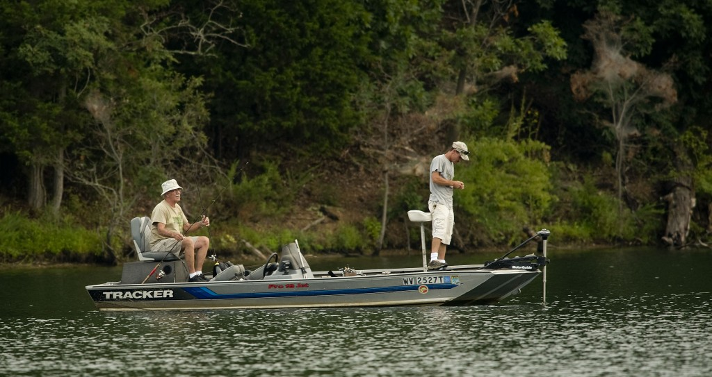 George Brubaker, left, and Anthony Saylor, both from Martinsburg, West Virginia, fish on a quiet summer morning at Lake Frederick near Stephens City.  Rich Cooley/Daily