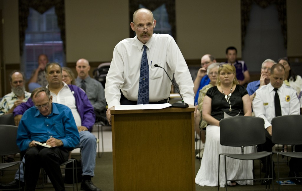 Chris Ritenour, president of he Strasburg Fire Department, addresses Strasburg Town Council on Tuesday night.  Rich Cooley/Daily