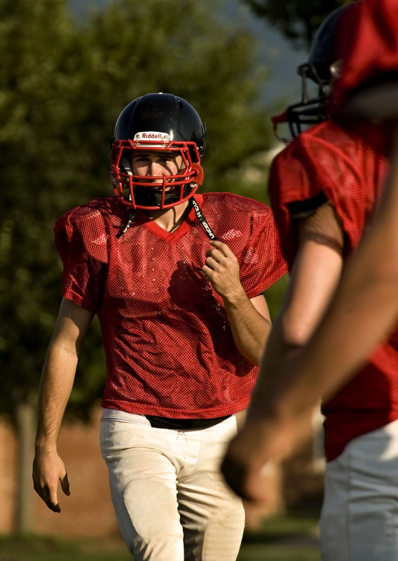 Stonewall's Nathan Miller walks onto the field during a recent practice.  Rich Cooley/Daily