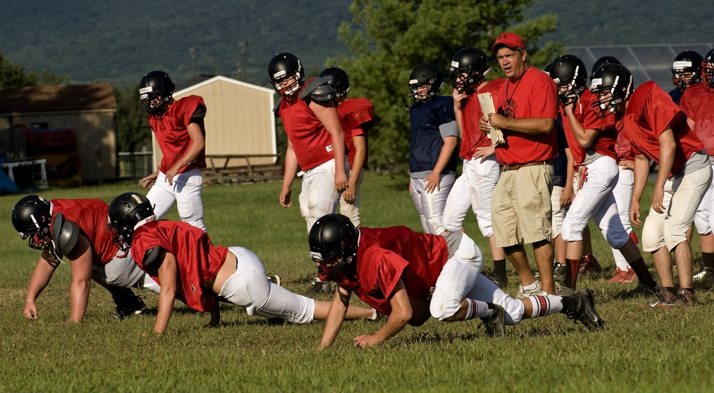 Stonewall Jackson's new head coach Jay Goode works players during a recent practice.  Rich Cooley/Daily