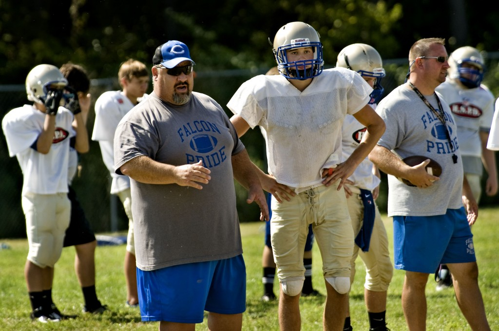 Central High School football coach Mike Yew gives instructions during a recent practice.  Rich Cooley/Daily