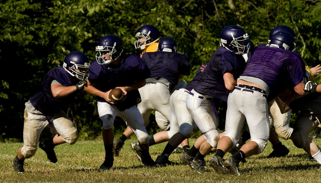 Strasburg High School's offense runs a play during a drill at a recent practice.  Rich Cooley/Daily