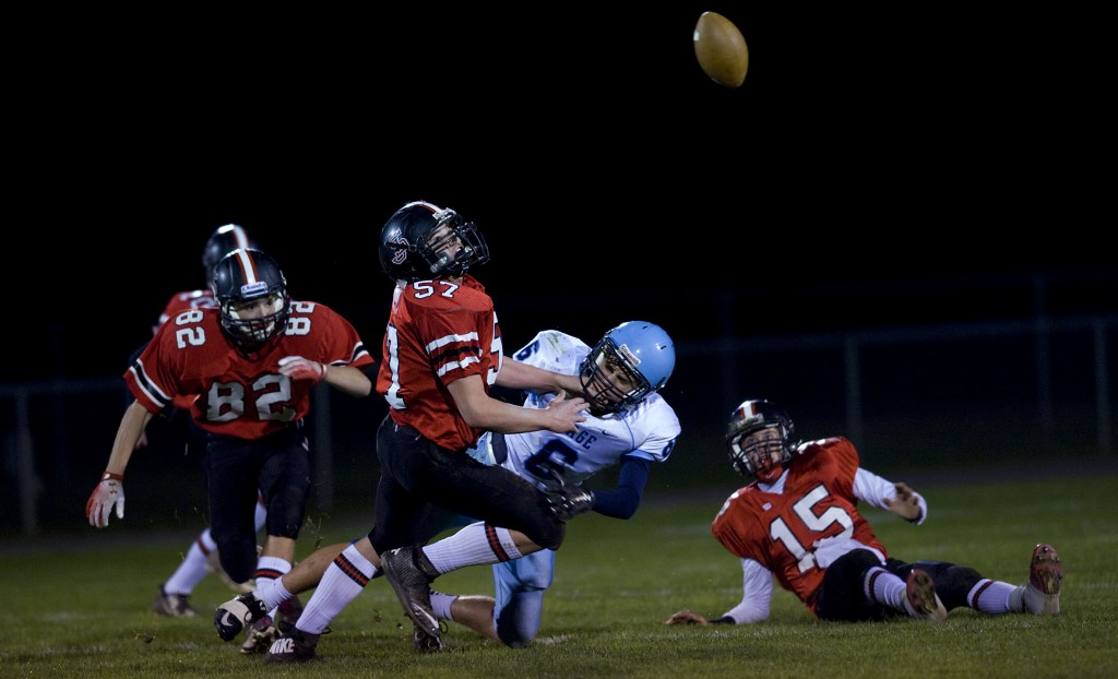 Stonewall's Coy Wilkerson (57) looks up for the ball as Page County's Jacob Day prepares to hit the ground on this  pass play during their game last season in Quicksburg. Rich Cooley/Daily file