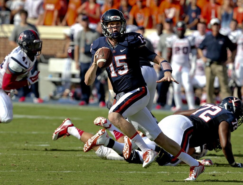 Virginia quarterback Matt Johns scrambles during a game last season. Courtesy photo/Virginia Athletics Communications