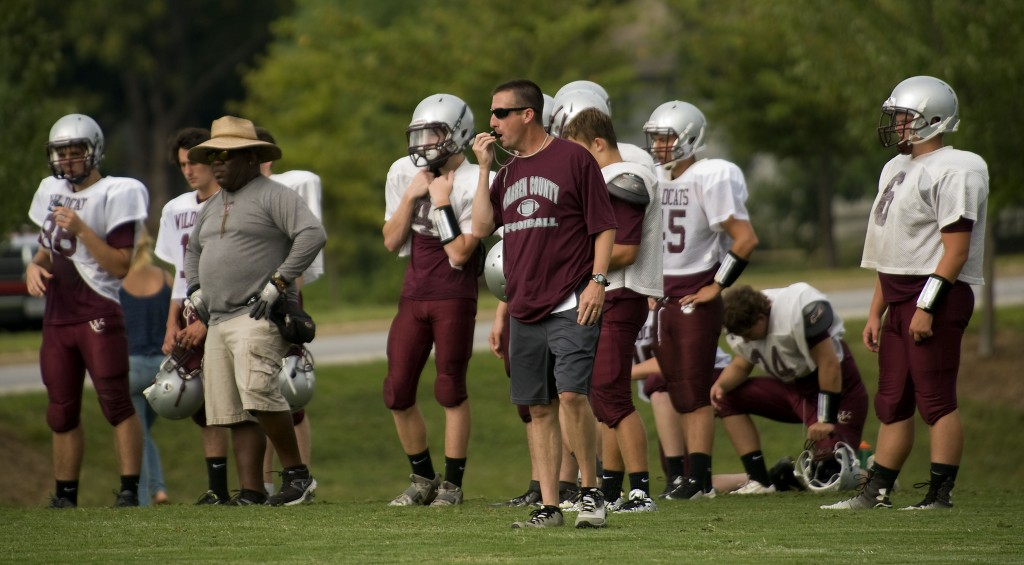 Warren County head coach Steve Crist runs a recent practice session on the school's practice field. Rich Cooley/Daily