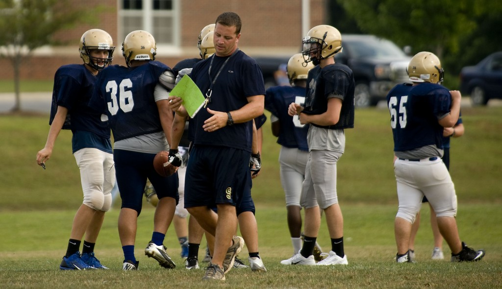 Skyline High School head coach Heath Gilbert looks over his list during a recent  practice.  Rich Cooley/Daily