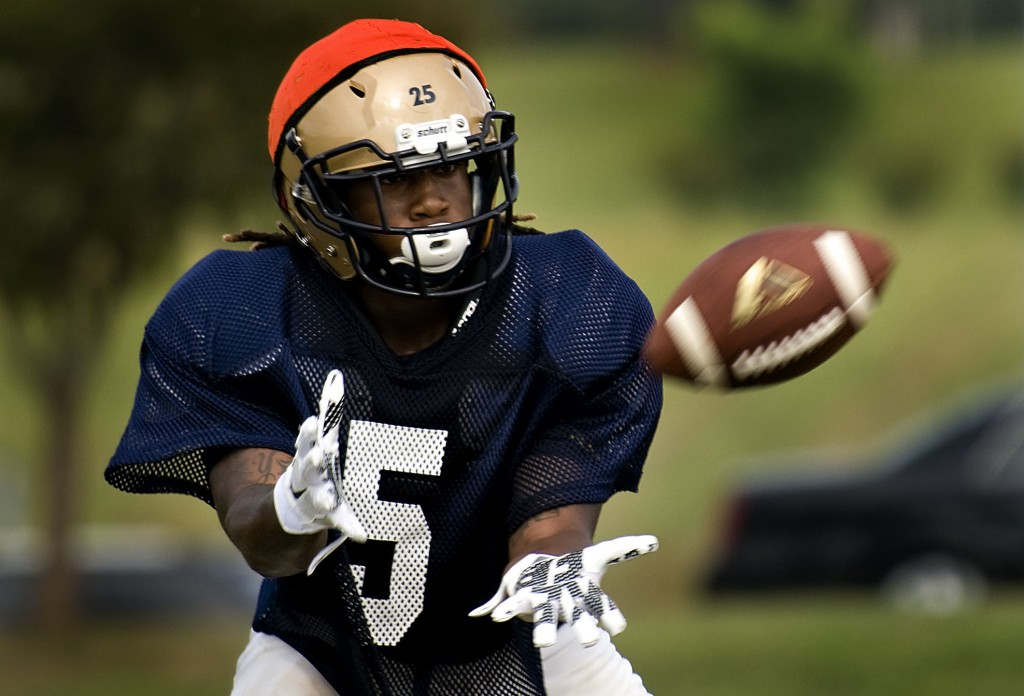 Skyline's Jay Roy catches the ball during a practice. Rich Cooley/Daily