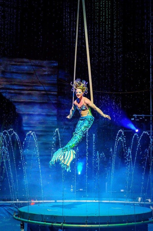 Cirque Italia artist Morgaine Rosenthal performs her mermaid straps act over the circus' water stage. Photo courtesy of Cirque Entertainment