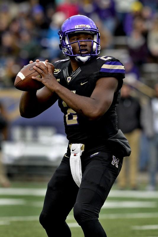 JMU quarterback Vad Lee looks to make a throw during a game last season. Lee threw for a school-record 3,462 yards last year. Courtesy photo/JMU Athletics Communications