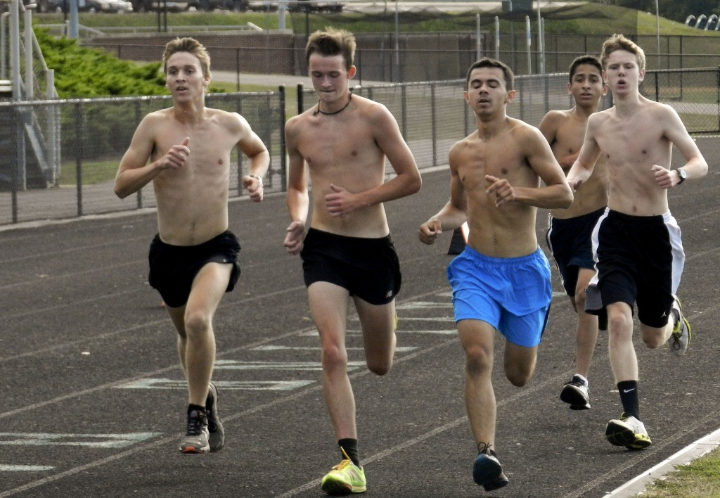 Skyline seniors Christian Madden, left, Tanner Steed, center, and Demetry Arnold lead the Hawks' boys cross country team during a workout Wednesday afternoon in Front Royal.   Brad Fauber/Daily