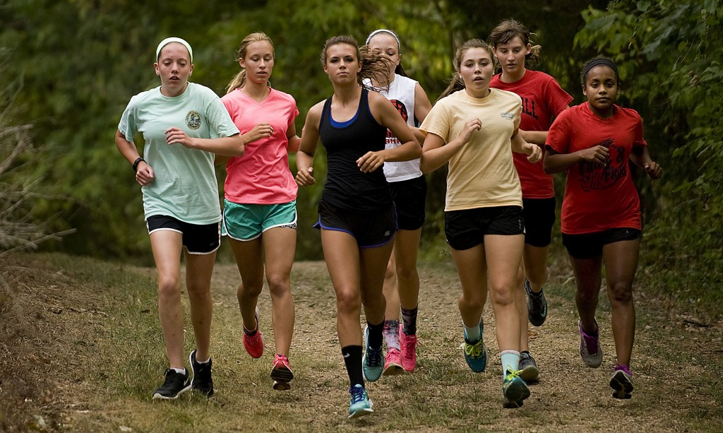 Hayley Gibson, center, leads a group of Stonewall Jackson High School Cross Country girls during a recent training run at the New Market Battlefield Park.  Rich Cooley/Daily