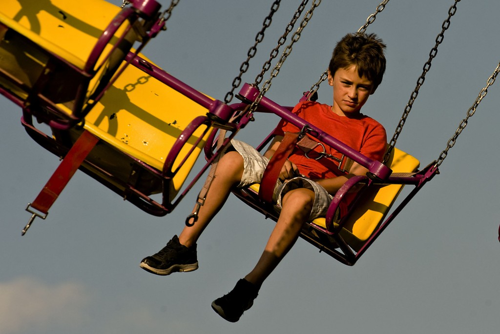 Dane Schillinger, 7, of Fairfax, takes a ride on the swings during opening night of the Shenandoah County Fair at the fairgrounds in Woodstock on Friday. The fair will run through Sept. 5.  Rich Cooley/Daily