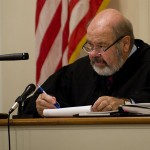 Shenandoah County Circuit Court Judge Dennis Hupp listens to attorney David Downes' comments concerning his client John Charles Taveras during circuit court proceedings on Monday.  Rich Cooley/Daily
