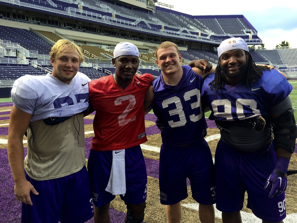 From left to right, JMU's Deane Cheatham, Vad Lee, Gage Steele and Alex Mosley pose after Saturday's practice. They  were selected captains for the upcoming season. Courtesy photo/JMU Athletics Communications.