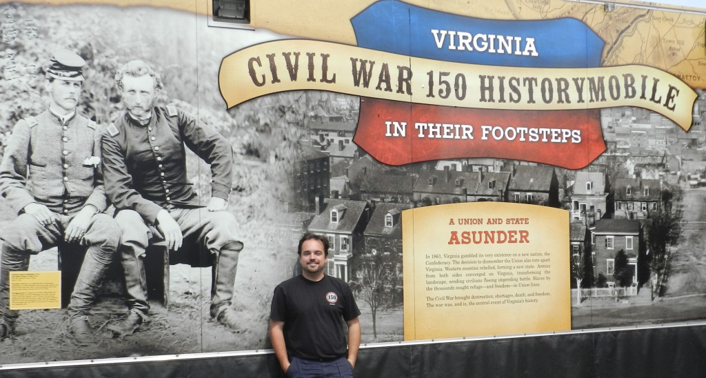 Rusty Nix, 30, of Lynchburg, stands in front of the Civil War 150th History Mobile, where he shows fairgoers Virginia's  rich Civil War history.  Kaley Toy/Daily