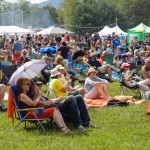 The crowd settles in to enjoy one of the 20 some bands scheduled to play over the Labor Day  weekend at  the Appaloosa Roots Music Festival. Linda Ash/Daily