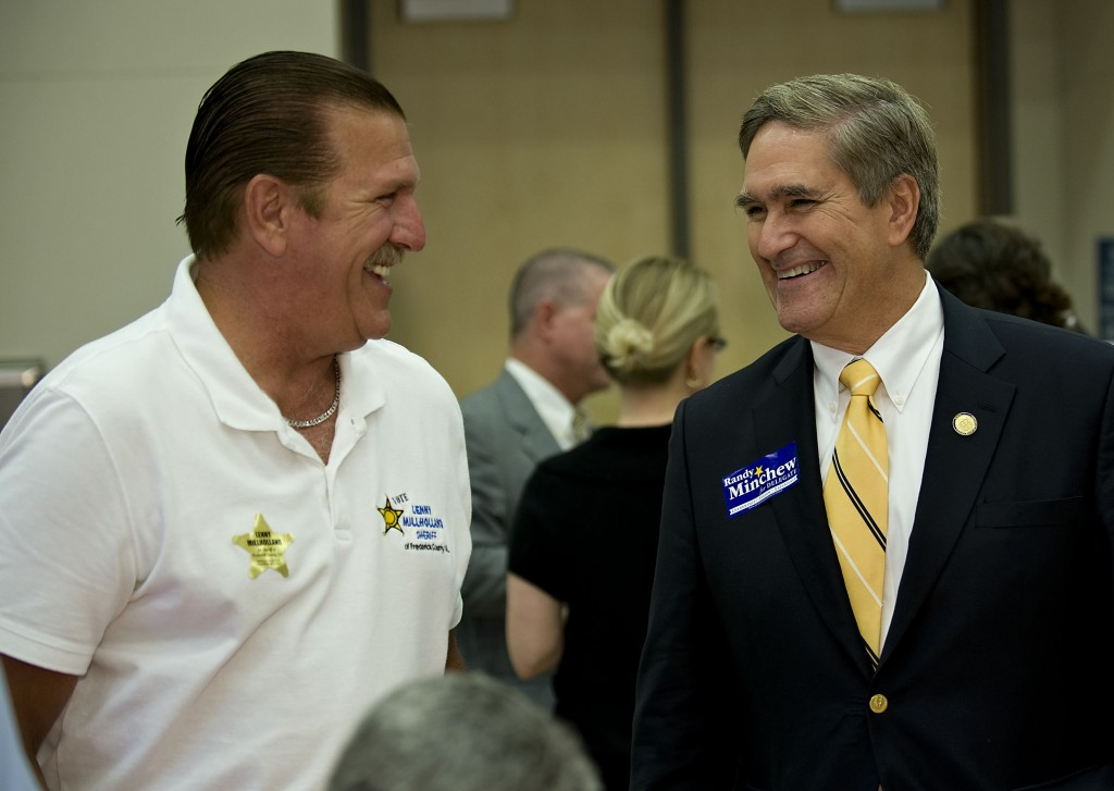 Lenny Milholland, left, an independent candidate for Frederick County sheriff, chats with 10th District Delegate Randy Minchew during the Hob Nob held Friday evening at Lord Fairfax Community College.  Rich Cooley/Daily