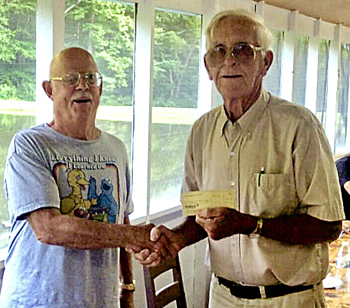 South Warren Ruritan Club President Rick Logan presents the club's annual $400 gift to Habitat for Humanity.  Receiving the gift is local Habitat volunteer and club member Ashby Crowder.  The presentation was made at the club's annual family picnic meeting in August. Courtesy photo