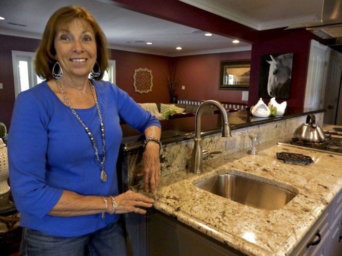 Pat Snapp drew inspiration for her kitchen's deep color scheme from inclusions in her granite countertop. Her Winchester home will be featured in Saturday's Kitchen Kapers tour. Rachel Mahoney/Daily