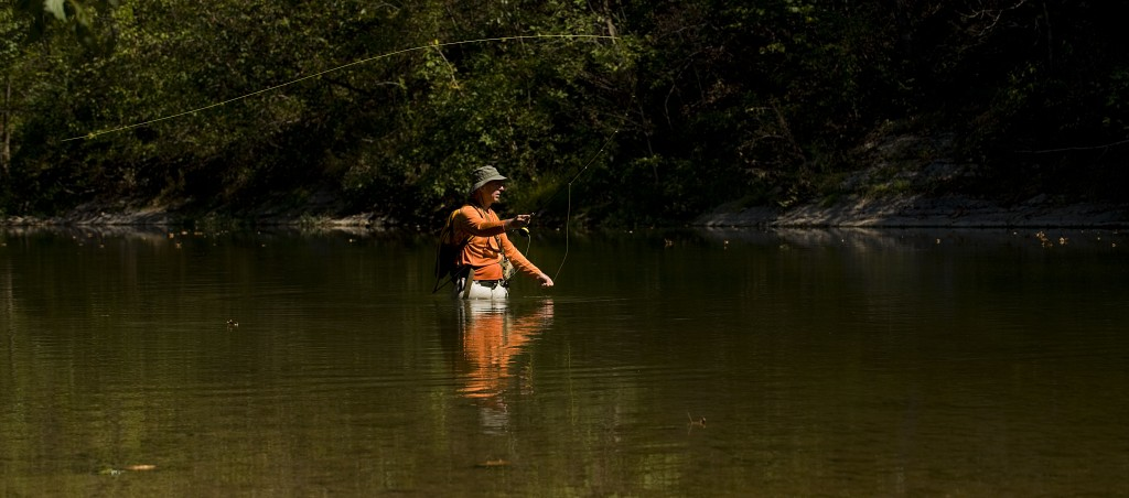 Steve Napoliello, of Manassas, fishes with his fly rod along the North Fork of the Shenandoah River at Chapmans Landing north of Edinburg recently.  Rich Cooley/Daily