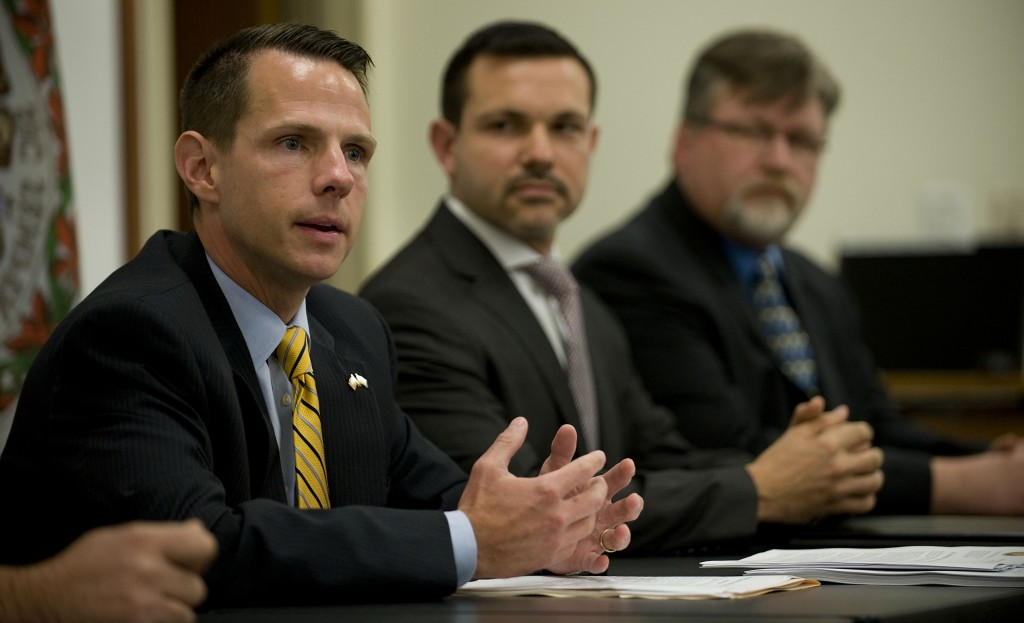 William J. Ihlenfeld, II , left, U.S. attorney for the Northern District of West Virginia, speaks during a news conference about cigarette smuggling indictments on Monday at the Frederick County Sheriff's Office in Winchester.  At center is Steve Schrank, assistant special agent in charge of Homeland Security Investigations, El Dorado Task Force, and at right, Andrew P. Kondisko, resident agent in charge, Department of Homeland Security in Harrisonburg. Rich Cooley/Daily